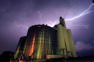 Lightning from a severe storm fills the sky behind a grain elevator in Belvue, Kan., Wednesday, May 25, 2016. The storm produced tornadoes near Chapman, Kan.
