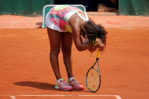 Japan's Naomi Osaka reacts to loosing her third round match of the French Open tennis tournament against Romania's Simona Halep at the Roland Garros stadium in Paris, France, Friday, May 27, 2016. (AP Photo/Christophe Ena)