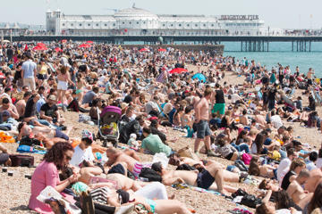 Seasonal weather, Britain - 08 May 2016 Thousands of people take to the beach in Brighton to sunbathe as temperatures reach 22C down the South Coast.