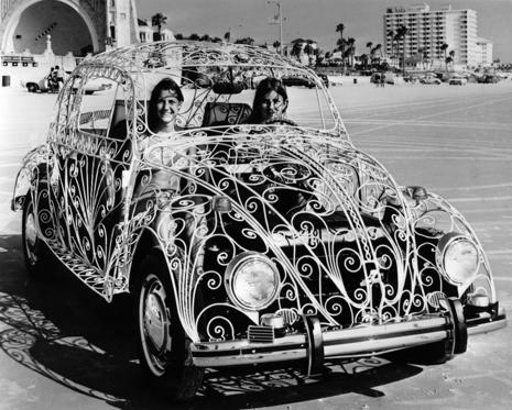 20th July 1972:  Two women sit in their Volkswagen Beetle car which has been customized with a wrought-iron body at Daytona Beach, Florida.  (Photo by Alan Band/Keystone/Getty Images)