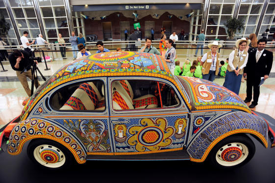 The Vochol is a 1990 Volkswagen Beetle that has been covered with 2,270,000 glass beads in a traditional Huichol form of craftwork. Glass and plastic beads have replaced the seeds that were originally used by the Huichol in their art. Huichol is an indig