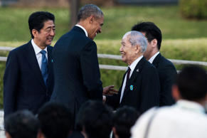 US President Barack Obama shakes hands with Sunao Tsuboi, a survivor of the atomic bombing of Hiroshima, as Japanese Prime Minister Shinzo Abe (L) looks on at the Hiroshima Peace Memorial park cenotaph in Hiroshima on May 27. Obama became the first sitting US leader to visit the site that ushered in the age of nuclear conflict.