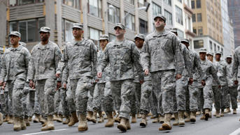 Military personnel march in the annual Veteran's Day parade in New York, Wednesday, Nov. 11, 2015.