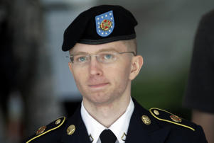 FILE - In this June 5, 2013, file photo Army Pvt. Chelsea Manning, then-Army Pfc. Bradley Manning, is escorted out of a courthouse in Fort Meade, Md., after the third day of his court martial.