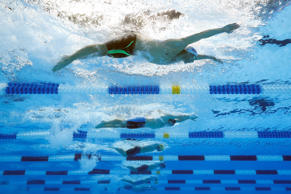 Michael Phelps, Tim Phillips and Seth Stubblefield of the United States compete ...