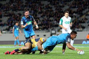 Jerome Kaino of the Blues scores a try during the round 16 Super Rugby match between the Blues and the Brumbies at Eden Park on July 8, 2016 in Auckland, New Zealand.