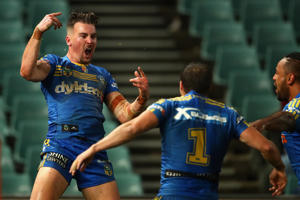 Clint Gutherson of the Eels celebrates scoring a try with team mates during the round 18 NRL match between the Parramatta Eels and the Sydney Roosters at Pirtek Stadium on July 8, 2016 in Sydney, Australia.