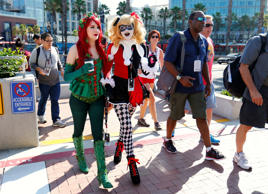 Attendees dressed as Poison Ivy and Harley Quinn arrive for opening day of the annual Comic-Con International in San Diego, California, United States July 21, 2016. REUTERS/Mike