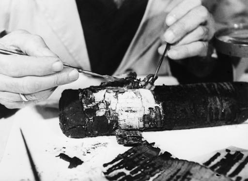 (Original Caption) Dead Sea Scrolls: An intricate and delicate operation in process of restoring Dead Sea Scrolls, is performed by Professor Bieberharant, in 1955, at the Israel Special Museum, House of the Book, Jerusalem, Israel. Undated photograph.