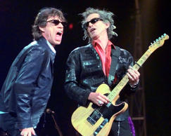 "In this Monday, March 22, 1999, file photo, Mick Jagger, left, and Keith Richards perform ""Jumping Jack Flash"" during the Rolling Stones' No Security Tour performance at the Fleet Center in Boston."