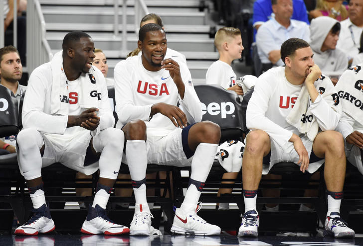 Draymond Green, Kevin Durantand Klay Thompson talk on the bench during a USA Basketball showcase exhibition game against Argentina on July 22, 2016 in Las Vegas.