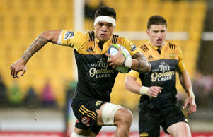 Vaea Fifita of the Hurricanes breaks away to score a try.