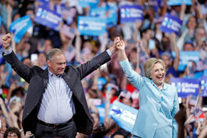 Democratic presidential candidate Hillary Clinton arrives with Sen. Tim Kaine, D...