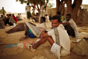Ethiopian migrants rest near a transit center where they are waiting for repatriation in the western Yemeni town of Haradh, on the border with Saudi Arabia March 21, 2012. Some 12,000 migrants, mostly from the Horn of Africa, are stranded in Haradh, whic