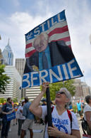 Activists including hundreds of environmentalists and Bernie Sanders supporters march through downtown Philadelphia before the start of the Democratic National Convention.