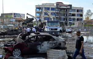 File: Iraqi security forces and civilians gather at the site of a car bomb attack in Baghdad October 21, 2014.