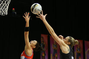 Sharni Layton goes for the rebound for the Swifts (L) with Magic shooter Ellen Halpenny (R) during the ANZ Championship Semi Final match between the Magic and the Swifts at Claudelands Arena on July 25, 2016 in Hamilton, New Zealand.