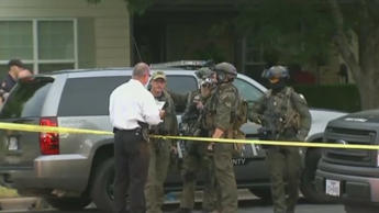 Video still of the scene outside the home of Travis County Sheriff's Deputy Craig Hutchinson in Round Rock, Texas.