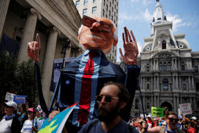 A giant puppet of Bernie Sanders is carried as protesters march against presumptive Democratic presidential nominee Hillary Clinton, ahead of the Democratic National Convention, in Philadelphia.