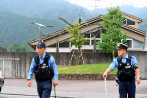 Police officers are seen in front of a facility for the disabled where at least ...