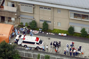 Police officers and rescue workers are seen in a facility for the disabled, where at least 19 people were killed and as many as 20 wounded by a knife-wielding man, in Sagamihara, Kanagawa prefecture, Japan, in this photo taken by Kyodo July 26, 2016.