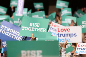 PHILADELPHIA, PA - JULY 25: People holds signs on the first day of the Democratic National Convention at the Wells Fargo Center, July 25, 2016 in Philadelphia, Pennsylvania. An estimated 50,000 people are expected in Philadelphia, including hundreds of protesters and members of the media. The four-day Democratic National Convention kicked off July 25. (Photo by Paul Morigi/WireImage)