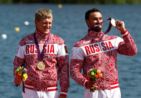 Russia's gold medallists Yury Postrigay (L) and Alexander Dyachenko stand on the podium during the victory ceremony for the men's kayak double (K2) 200m event at Eton Dorney during the London 2012 Olympic Games August 11, 2012.