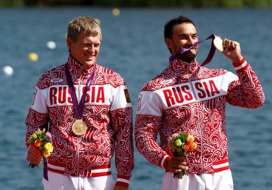 Slide 1 of 29: Russia's gold medallists Yury Postrigay (L) and Alexander Dyachenko stand on the podium during the victory ceremony for the men's kayak double (K2) 200m event at Eton Dorney during the London 2012 Olympic Games August 11, 2012.