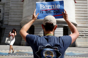 A supporter of Sen. Bernie Sanders, I-Vt., holds up a protest sign in Philadelphia, Tuesday, July 26, 2016, during the second day of the Democratic National Convention.
