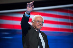Sen. Bernie Sanders, I-Vt., waves before addressing the crowd at the Wells Fargo...