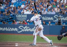 Toronto Blue Jays third baseman Josh Donaldson reacts after hitting a two run ho...