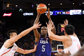 USA guard Kevin Durant passes the basketball against China forward Zhou Peng and...