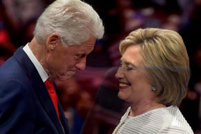 Hillary Clinton shares a moment on stage with husband, former US president Bill Clinton