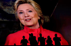 The silhouettes of photographers are seen as Hillary Clinton, 2016 Democratic pr...