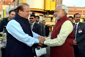 File: Prime Minister of Pakistan Nawaz Sharif (L) shakes hands with Indian Prime Minister Narendra Modi (R) at Allama Iqbal International Airport in Lahore, Pakistan on December 25, 2015