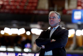 Democratic Vice Presidential candidate, Sen. Tim Kaine, D-Va., looks over the podium as he checks out the stage before the start of the third day session of the Democratic National Convention in Philadelphia, Wednesday, July 27, 2016.