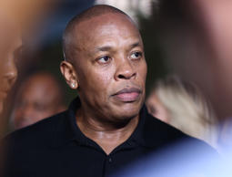 "In this Aug. 10, 2015, file photo, Dr. Dre arrives at the Los Angeles premiere of ""Straight Outta Compton."