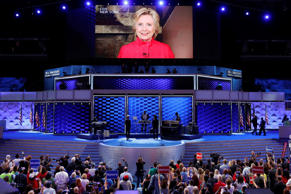 Democratic Presidential candidate Hillary Clinton appears on a large monitor to thank delegates during the second day of the Democratic National Convention in Philadelphia , Tuesday, July 26, 2016.