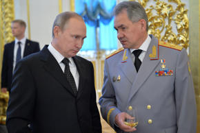 Russian President Vladimir Putin (L) talks to Defence Minister Sergei Shoigu during a reception to honour graduates of military academies at the Kremlin in Moscow, Russia, June 28, 2016.