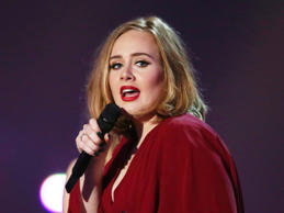 Adele invites impersonator on stage
