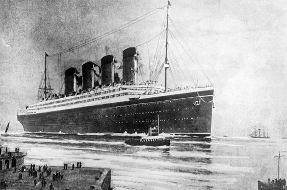 Slide 1 of 21: The White Star Line passenger liner R.M.S. Titanic embarking on its ill-fated maiden voyage.