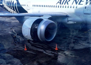 A photo tweeted by Andrea Vance of the damaged engine on an Air New Zealand flight that started smoking before a flight to Sydney.