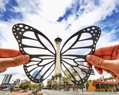 Quirky paper silhouettes - Jul 2016 A paper butterfly, that has been positioned on either side of a the Stratosphere building in Singapore