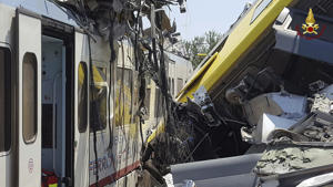 Crumpled wagon cars are seen after after two commuter trains collided head-on near the town of Andria, in the southern region of Puglia, killing several people.