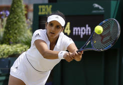 File: Sania Mirza of India returns to Neal Skupski and Anna Smith of Britain, during her mixed doubles match with partner Ivan Dodig of Croatia on day nine of the Wimbledon Tennis Championships in London, Tuesday, July 5, 2016.