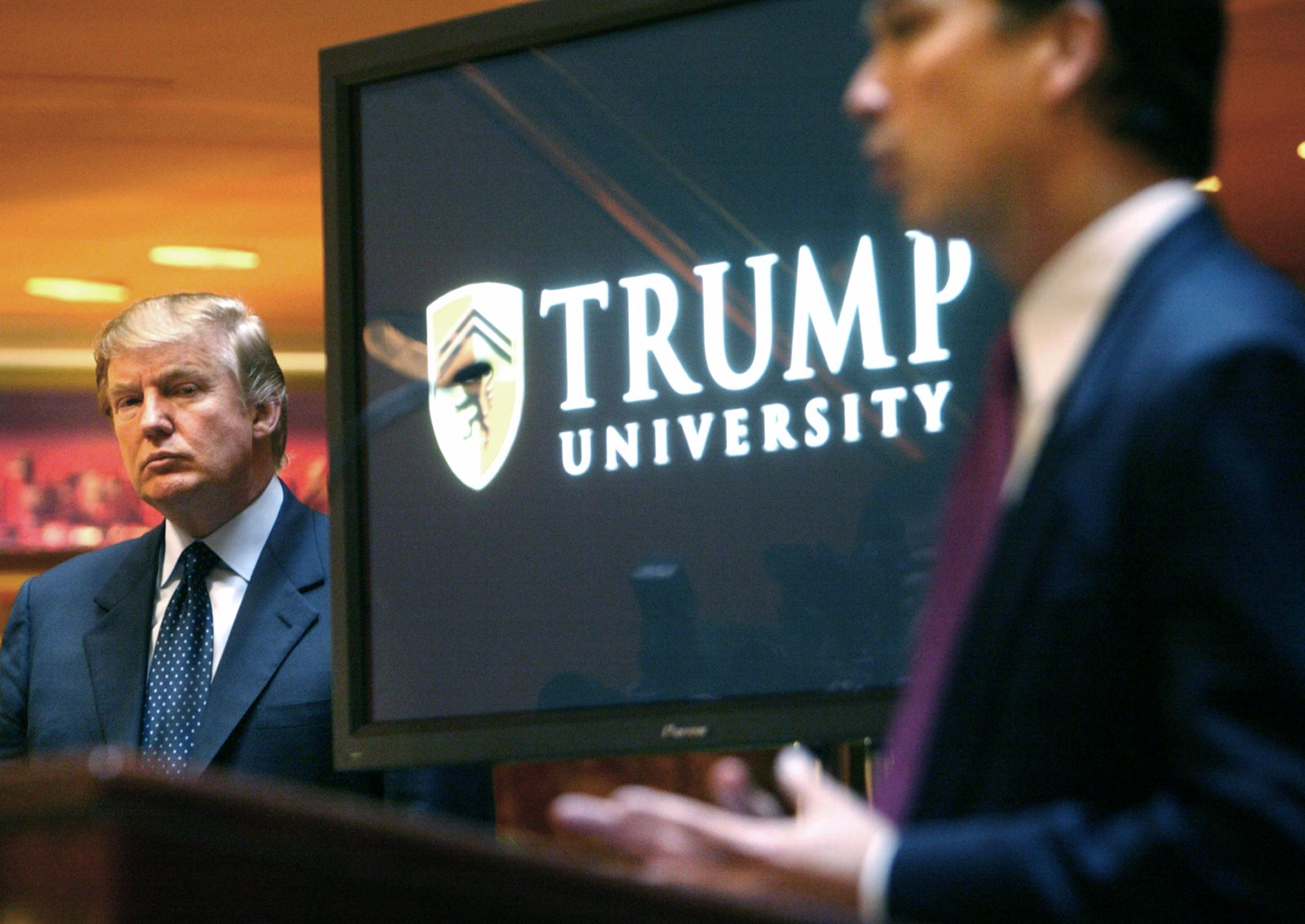 Appeals court weighs whether to reject Trump University settlement so former student can take the president to trial