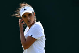 File: India's Sania Mirza takes part in a training session on the eleventh day of the 2016 Wimbledon Championships at The All England Lawn Tennis Club in Wimbledon, southwest London, on July 7, 2016.