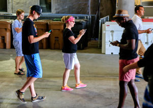 "Players follow their phones during a ""Pokemon Go"" event"
