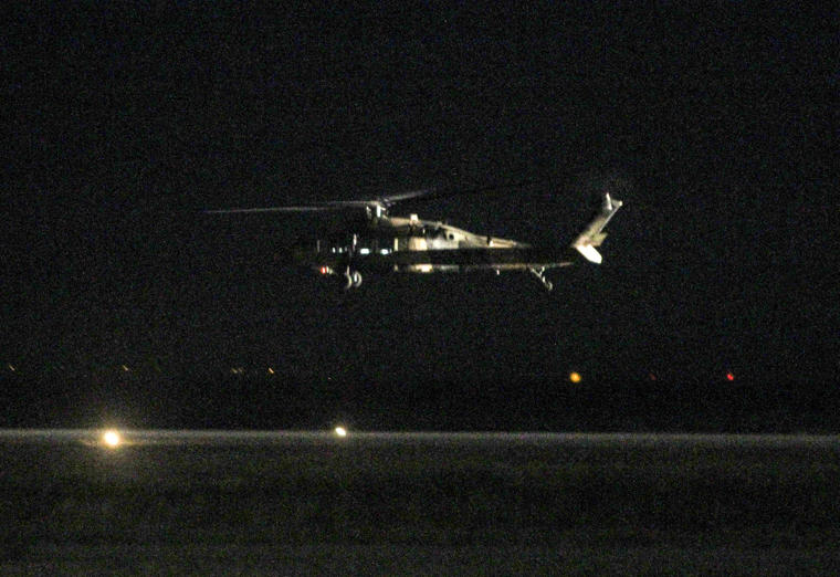 A Turkish Blackhawk helicopter takes off from the airport of Alexandroupolis, northern Greece, Sunday, July 17, 2016. A Blackhawk military helicopter with seven Turkish military personnel and one civilian landed in the Greek city of Alexandroupolis, wher