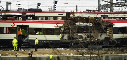 MADRID, SPAIN - MARCH 12:  One of the bomb damaged trains is towed past another at Atocha train station on March 12, 2004 in Madrid, Spain. According to judicial sources 198 people were killed in the series of three blasts.   (Photo by Bruno Vincent/Gett